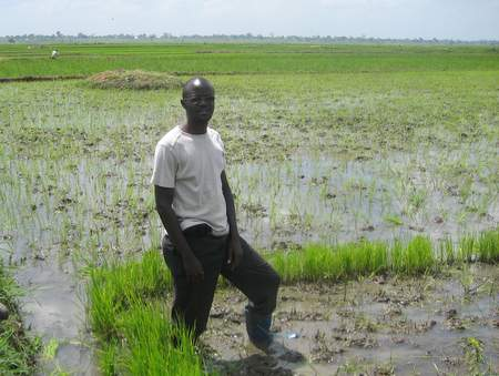 Ahmed Naleba, a young rice farmer in Uganda