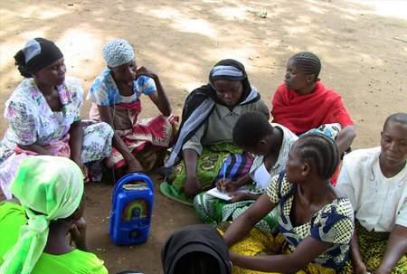 women group around radio