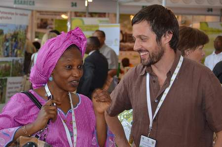 Naomi Sakana of IFPRI with ILRI's Ewen Le Borgne at AASW6. Forging partnerships between stakeholders is the key to a productive future, and the real value of the AASW6 conference.