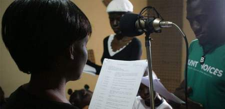 Actors run lines for a radio drama about a mother who discovers orange-fleshed sweet potatoes can cure her children of Vitamin A deficiency.