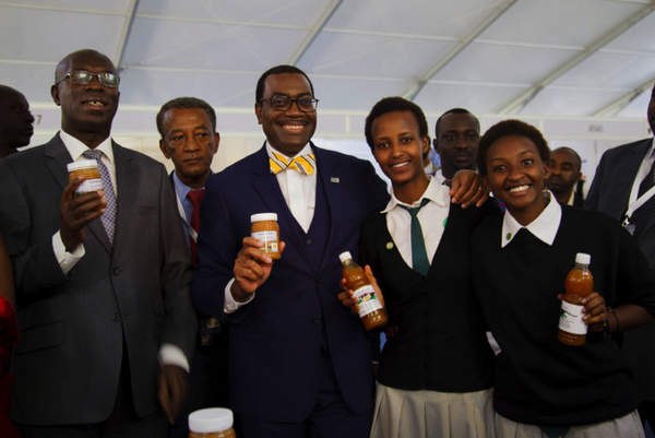 Anastase Murekezi, The Prime Minister of Rwanda  and Dr Akinwumi Adesina, President of the African Development Bank pose with students from Gashora Girls School, showcasing their products
